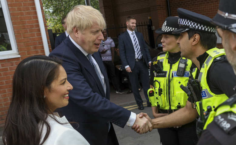 Boris Johnson, Priti Patel and the police. Photo: Flickr/Number 10