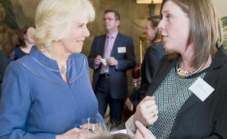 Jess Phillips conferring with the Duchess of Cornwall in 2013