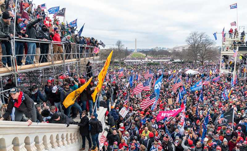 Trump supporters on Capitol Hill, Jan 6th. Photo: Blink O'fanaye / Flickr / cropped from original / CC BY-NC 2.0, license linked at bottom of article
