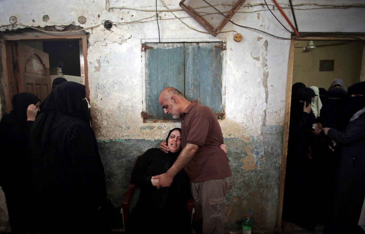 Palestinian relatives of eight members of the Al Haj family