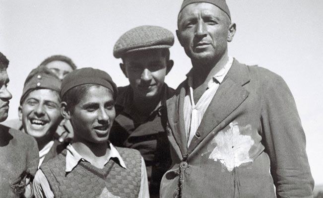 Jewish survivors of the Nazi concentration camps in Europe still wear the signs of their ordeal on their tattered clothing at the new immigrants' reception camp November 4, 1944 at Atlit, during the British Mandate of Palestine