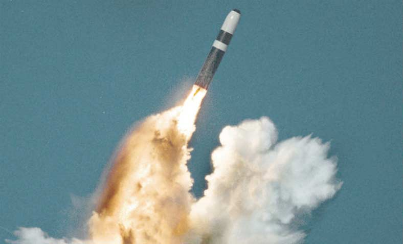 A Trident II missile fires its first stage after an underwater launch from a ballistic missile submarine. Photo: Wikipedia