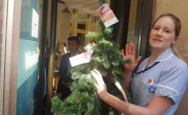 Nurses deliver the 'magic money tree' to the Department of health on 5th July. Photo: Danielle Tiplady