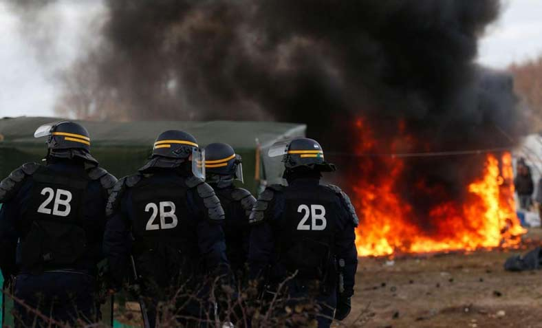 Twelve huts were set on fire during evictions from a camp in Calais. Photo: Wikipedia