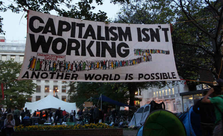 Banner at Occupy London in Finsbury Square, 2011. Photo: James Mitchell / Flickr