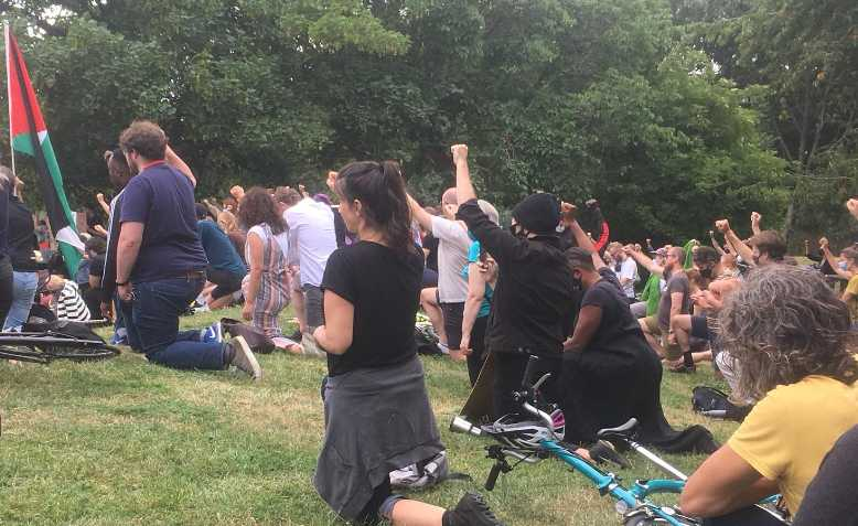 Taking the knee in Burgess Park. Photo: Cici Washburn