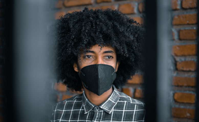 Person wearing face mask. Photo: Pexels