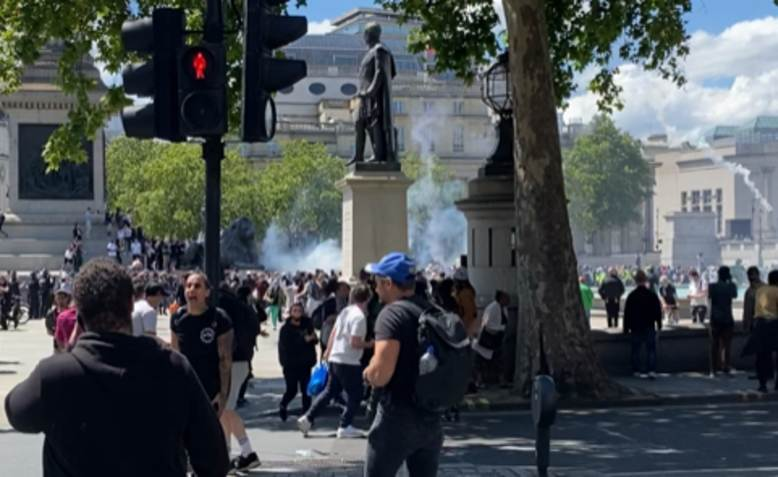 Fascists throwing lit fireworks at anti-racist protesters, Trafalgar Square. Photo: Clare Solomon