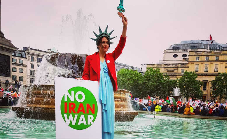 'No Iran War' at the demonstration against Trump, London, 4 June. Photo: Chrissy Brand