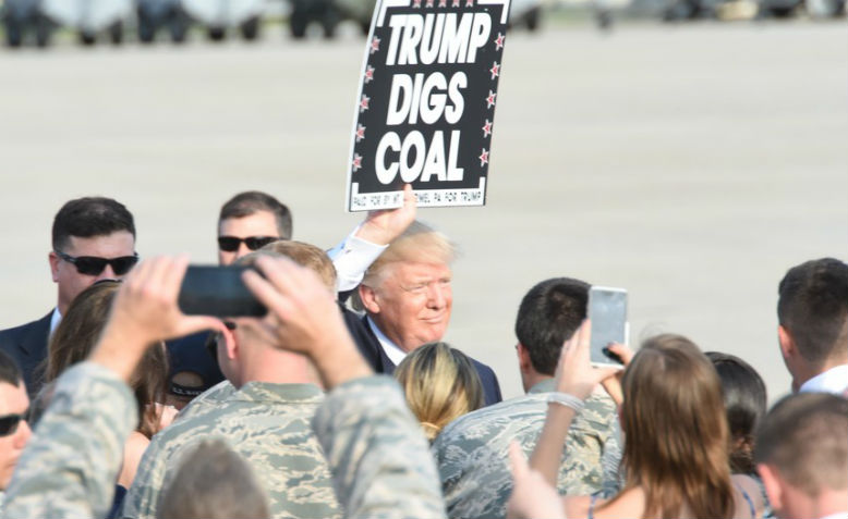 Trump with placard reading 'Trump digs coal'