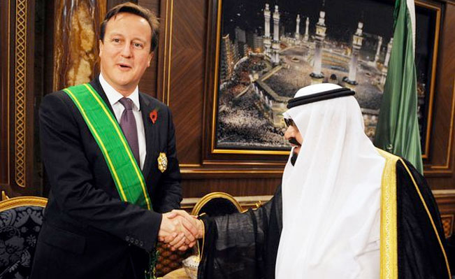 Mr Cameron receives the King Abdullah Decoration One from King Abdullah of Saudi Arabia