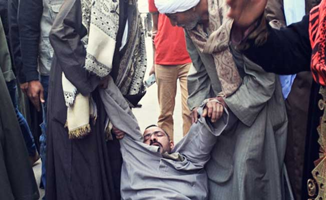 A relative of a defendant faints outside court in Minya after the death sentences were announced. Photograph: AFP/Getty Images