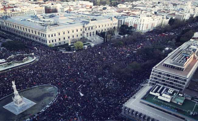 There were clashes between police and protesters as thousands of people rallied in the Spanish capital, Madrid