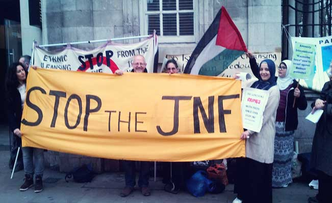 Stop the JNF banner at the protest
