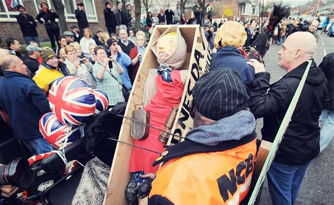 An effigy of former British prime minister Margaret Thatcher is placed in a 'coffin' as people gather to celebrate the death of Margaret Thatcher in Goldthorpe Photo: AFP