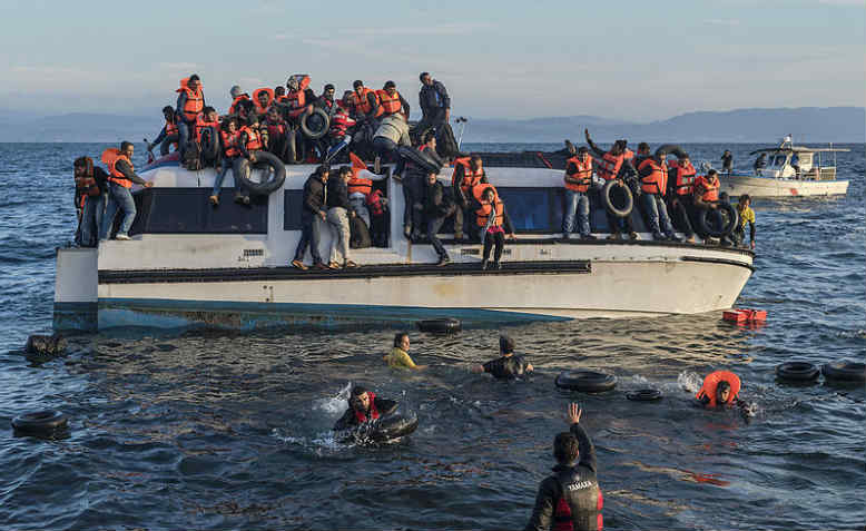 Refugees from Syria and Iraq arrive in Lesvos from Turkey. Photo: Wikipedia