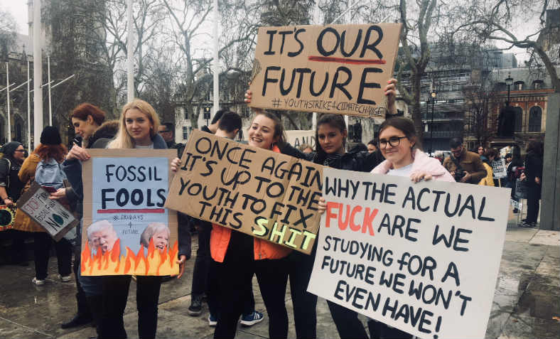 School students with vibrant political placards at the second Youth Strike 4 Climate on Friday in London. Photo: Feyzi Ismail