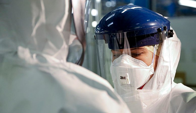 PPE checks during Ebola outbreak. Source: Wikipedia
