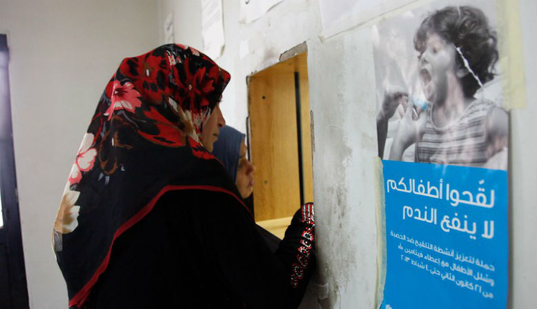 Two Syrian women collect a prescription at a health clinic. Source: Flickr - DFID