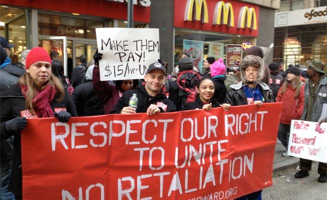 Workers from fast food and retail chains along State Street walk off their jobs in a protest for higher wages. Photo: John H. White - Sun-Times