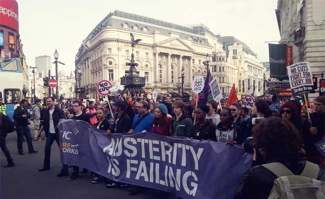 A march arrives at Piccadilly Circus. Photo credit: Arbolioto