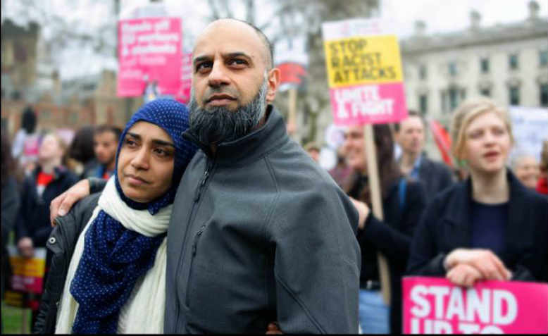 Couple joining the central London Stand Up to Racism demonstration, March 2017