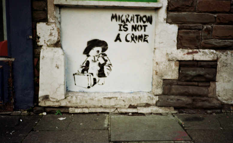 'Migration is not a crime' street art, Cardiff, 2011