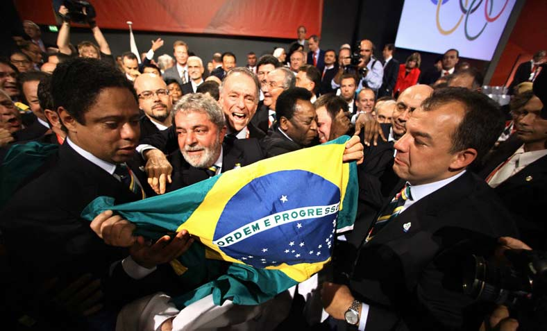 Lula, President of Brazil, holds a national flag during the celebration of the choice of Rio de Janeiro as the host city of the 2016 Summer Olympic Games