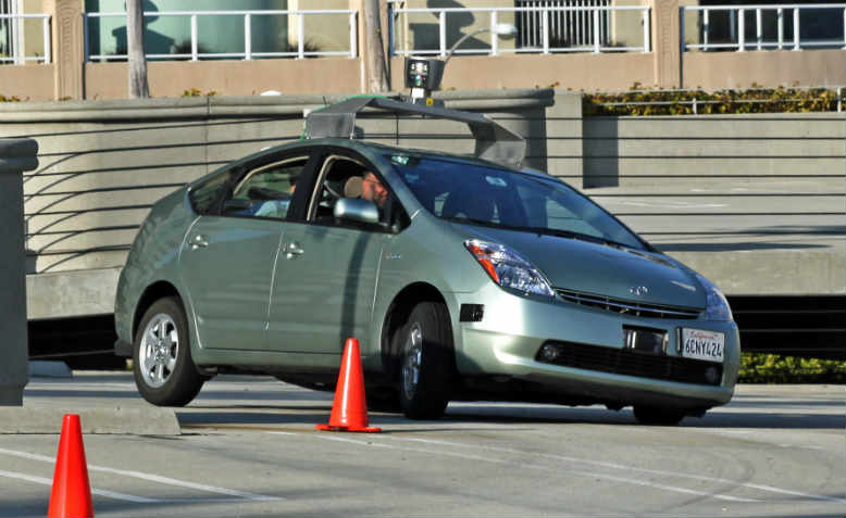 A Toyota Prius modified to operate as a Google driverless car navigating a test course, March 2011