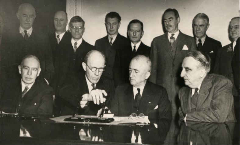 Keynes, bottom left, at the signing of the Anglo-American loan agreement in 1945. Photo: wikimedia commons