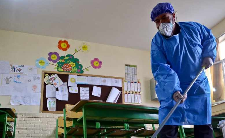 A worker disinfects a school against coronavirus in Bojnord, Iran. Source: Wikimedia - Peyman Hamidipoor