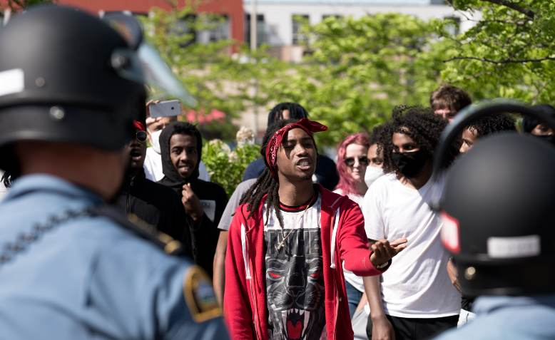 Protesters confronting police, Minneapolis 28 May. Photo: Flickr/Lorie Shaull
