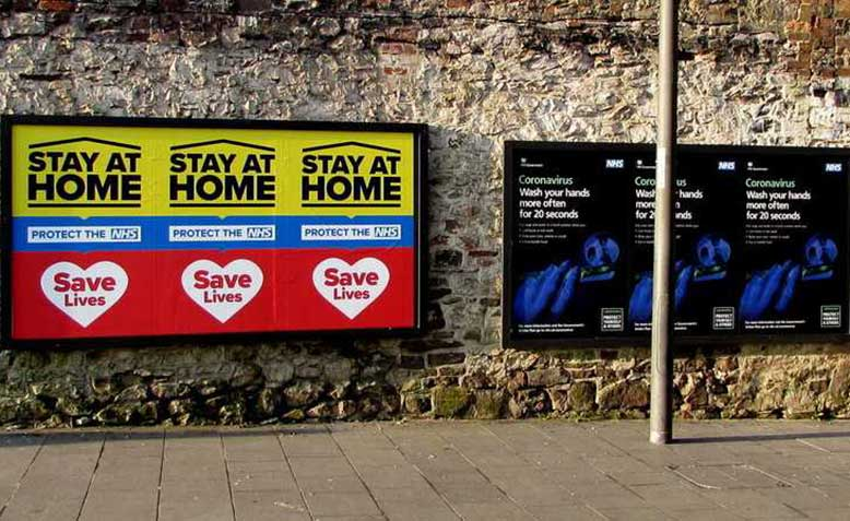 Stay at home posters in Newport town centre. Source: Geography.org.uk - Jaggery