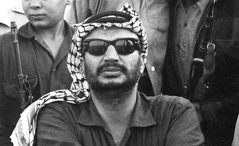 Yasser Arafat pictured in 1970, at a ceremony marking the end of a military training program in Damascus.AFP/Getty Images