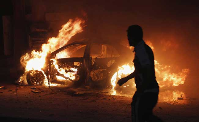 The site of a car bomb attack in Baghdad October 7, 2013. Photo:  Reuters/Ahmed Saad