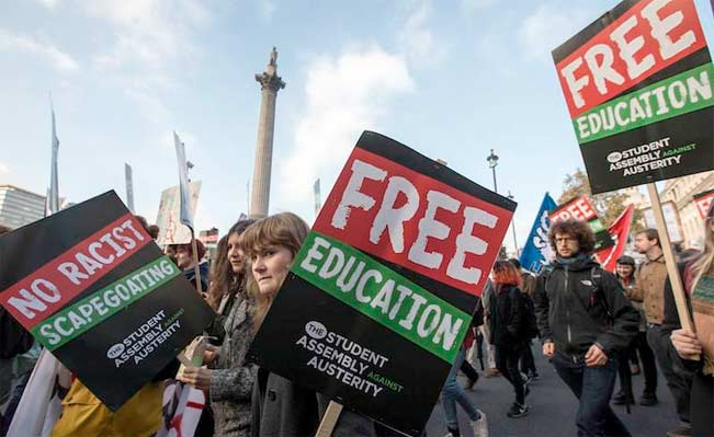 Demonstrators pass Nelson's Column in Trafalgar Square. Photo: Reuters