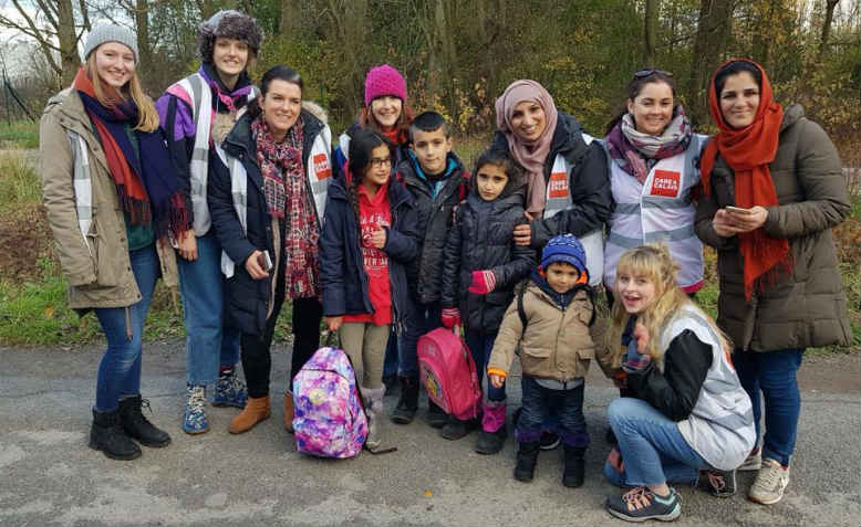 Care4Calais volunteers from Oxfordshire Refugee Solidarity with refugee families in Calais. Photo: David Bailey