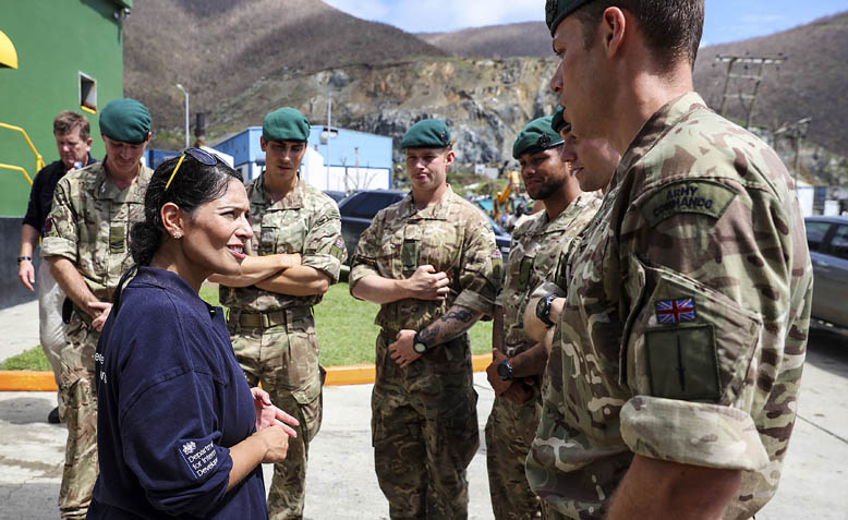 Priti Patel MP talking to Royal Engineers at Henry Wilfred Smith Power Station. Photo: Flickr / DFID