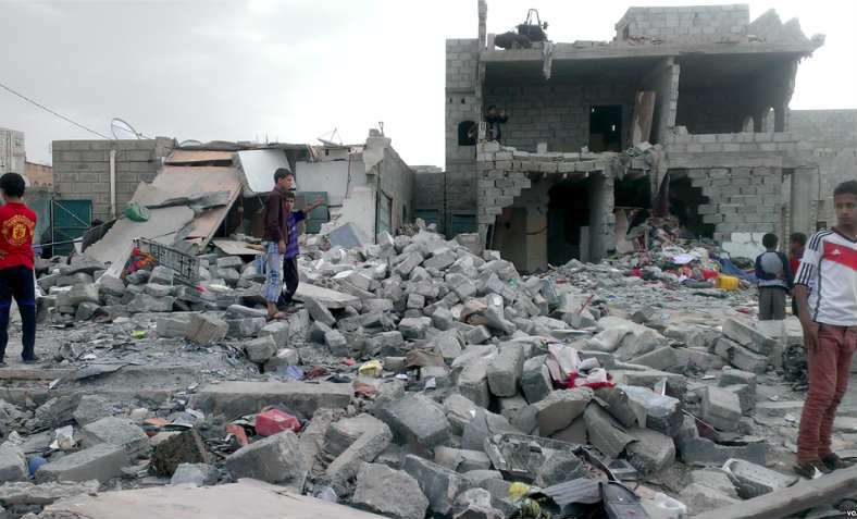 "Months after an airstrike on a neighborhood populated by black Yemenis or ""Muhamasheen"" more than a hundred buildings still remain in rubble and survivors continue to search for any valuables in Sanaa, Yemen, 9 October 2015. Photo: Wikimedia Commons."