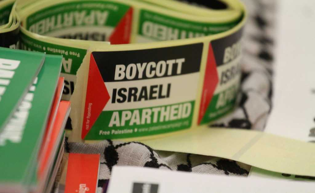 Boycott Israeli apartheid. Photo: Palestine Solidarity Campaign/cropped from the original/licensed under CC2.0, linked at the bottom of article