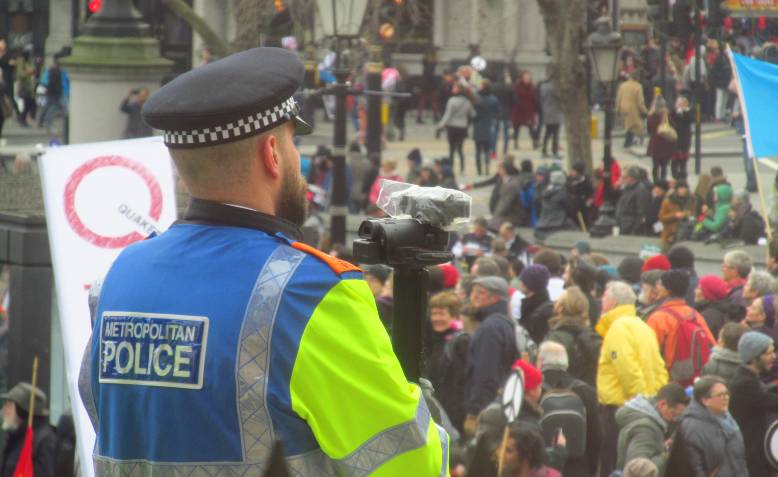 Police filming Stop Trident demonstration. Photo: David Holt / Wikimedia Commons / CC BY 2.0, license linked at bottom of article