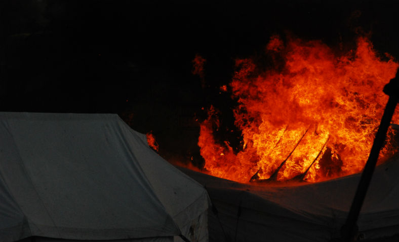 The Calais refugee camp on fire. Photo: Flickr/Michel Spekkers