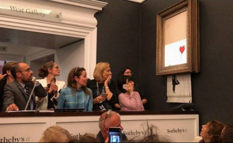 Girl with the Red Balloon shredding after it was sold at auction for over £1m. Photo: Instagram/Banksy