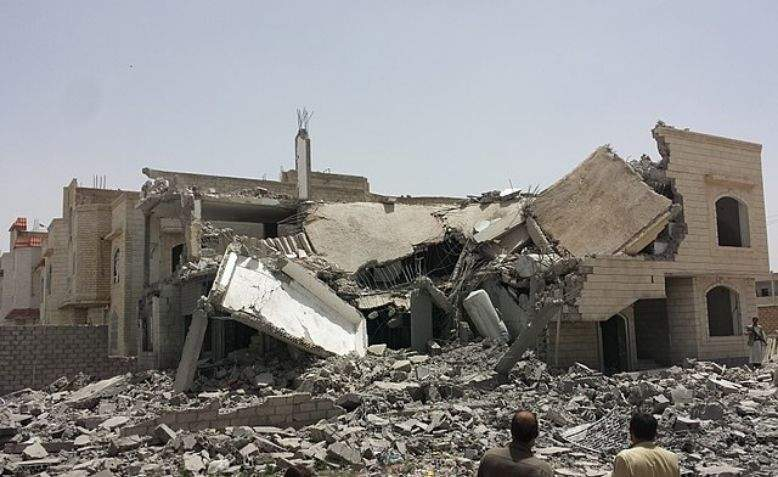 Destroyed house in South Sanaa, Yemen. Photo: Ibrahem Qasim / Wikimedia Commons /  cropped original image / licensed under CC 4.0, linked at bottom of article