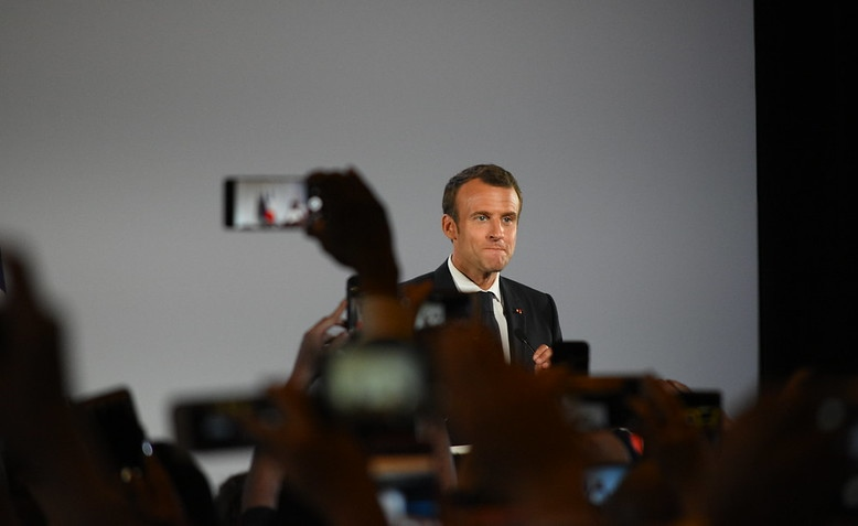 Emmanuel Macron making a speech. Photo: Amaury Laporte / Flickr / cropped from original / licensed under CC 2.0, links at the bottom of article