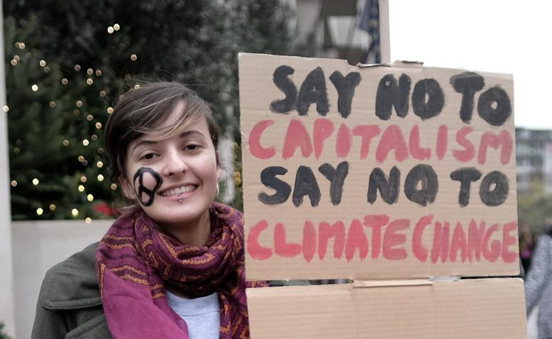 Climate march, London 2015. Photo: Alisdaire Hickson / Flickr / cropped from original / CC BY-SA 2.0, licence linked at bottom of article