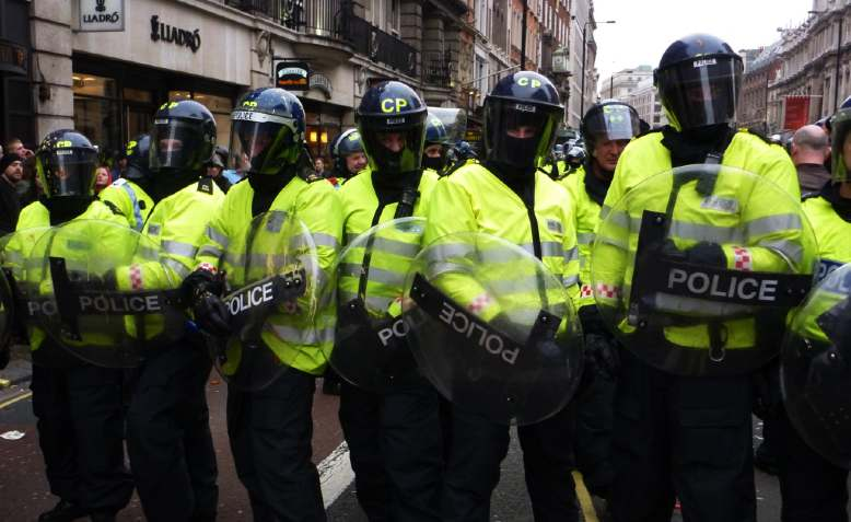 Police in London, March 2011. Photo: xpgomes5 / Flickr / CC BY-NC 2.0, license linked at bottom of article