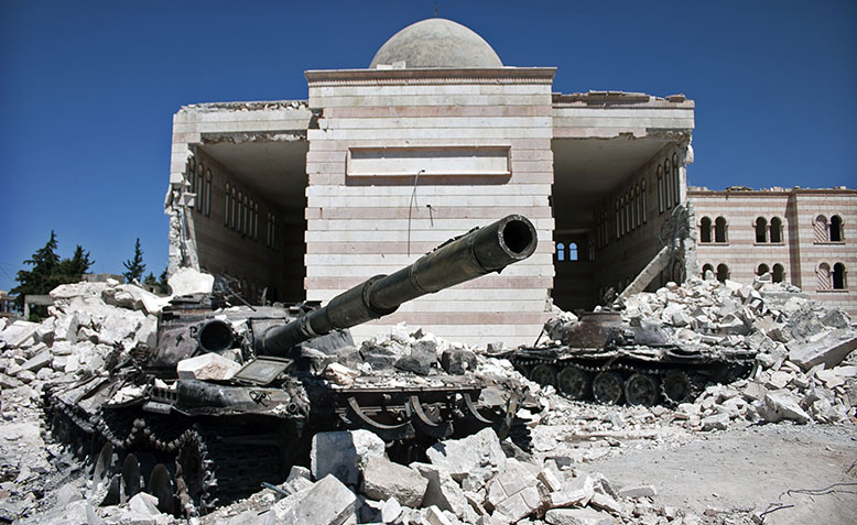 Two destroyed Syrian Army tanks in Azaz, August 2012. Photo: Flickr/ Christiaan Triebert