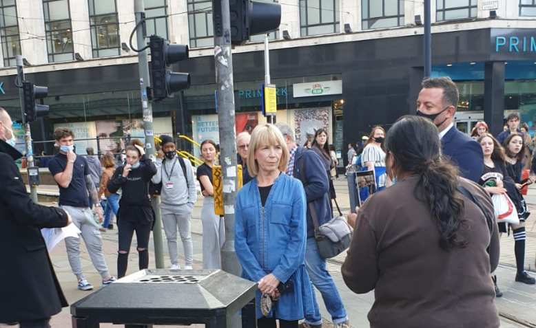 Laila Hassan confronts Debenhams store manager at Saturday's protest. Photo: Chris Neville