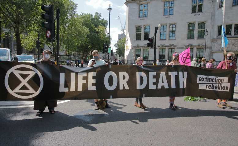 Extinction Rebellion, Parliament Square. Photo: Steve Eason / Flickr / CC BY-NC 2.0, licence and original photo linked at bottom of article